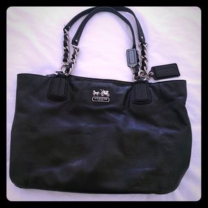 Coach carryall bag with zip closure.